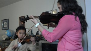 Clara and Kandace playing violins
