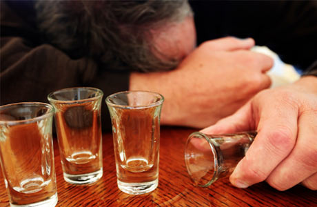 Drunk-Man-with-Empty-Shot-Glasses460x300