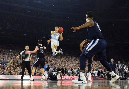 Apr 4, 2016; Houston, TX, USA; North Carolina Tar Heels guard Marcus Paige (5) shoots and scores a three point basket against the Villanova Wildcats in the second half in the championship game of the 2016 NCAA Men's Final Four at NRG Stadium. Mandatory Credit: Robert Deutsch-USA TODAY Sports