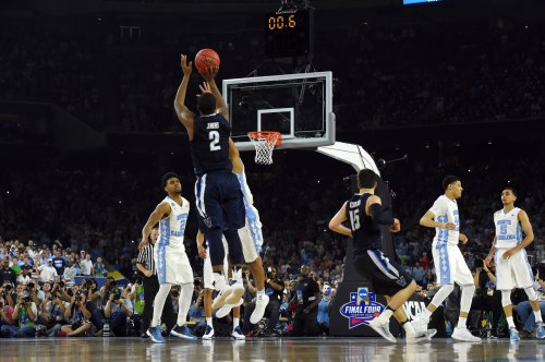 Apr 4, 2016; Houston, TX, USA; Villanova Wildcats forward Kris Jenkins (2) hits the game winning shot with .6 seconds over North Carolina Tar Heels forward Isaiah Hicks (4) in the championship game of the 2016 NCAA Men's Final Four at NRG Stadium. Mandatory Credit: Bob Donnan-USA TODAY Sports